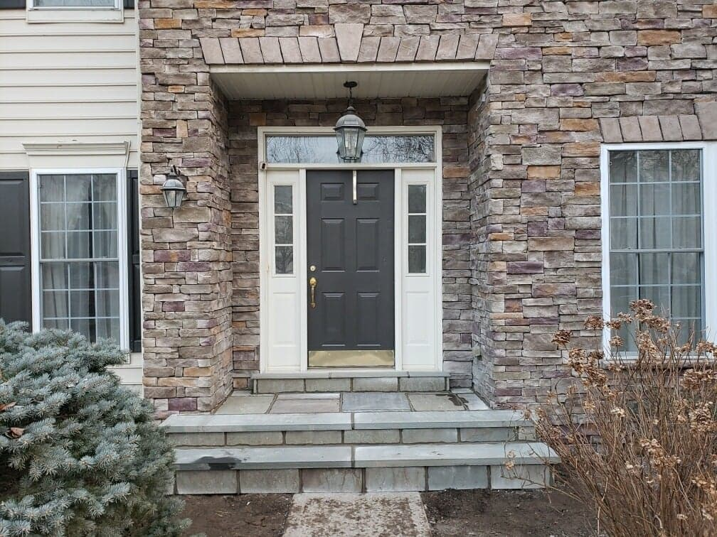 front steps to doorway with off-grey stone