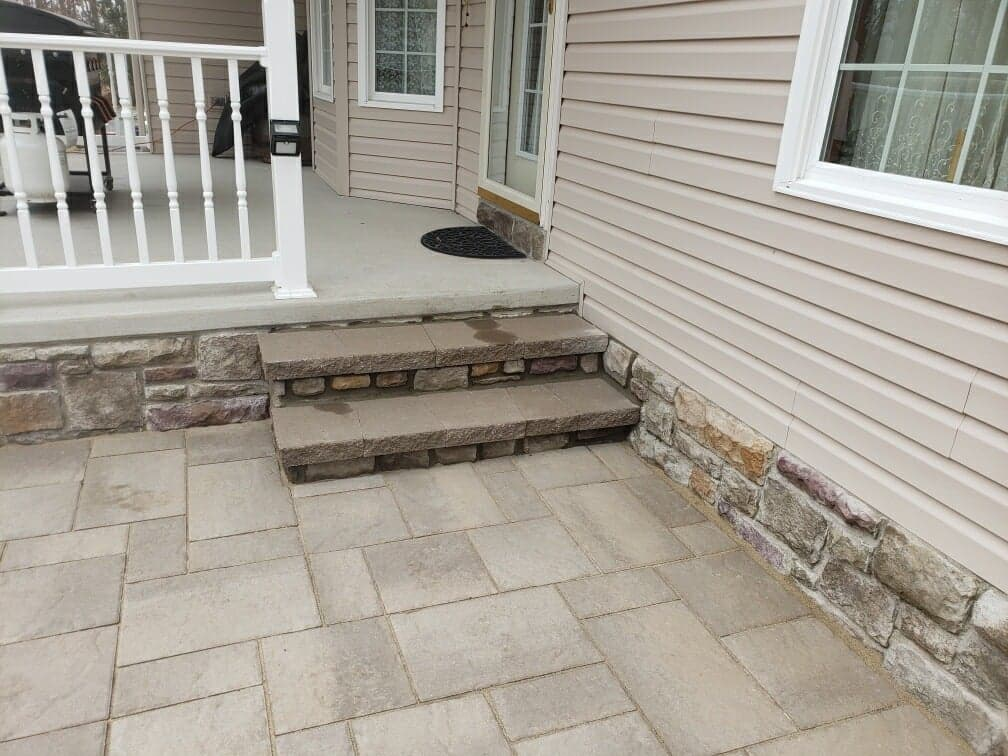 little steps from patio up to porch