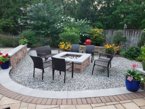 stone and pebble firepit custom hardscaping by A Stone's Throw