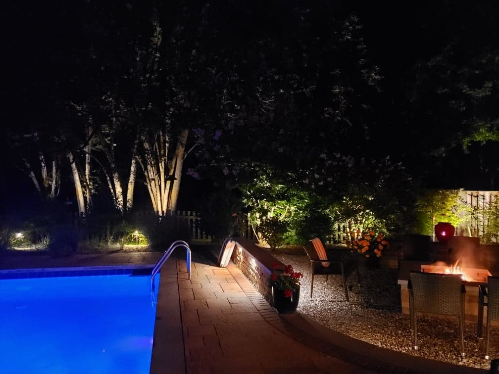 firepit and pool at night
