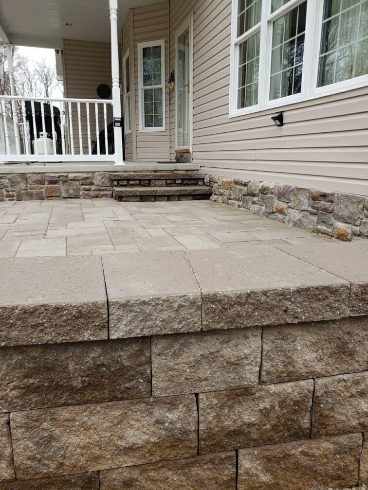 close up of stone wall around new patio