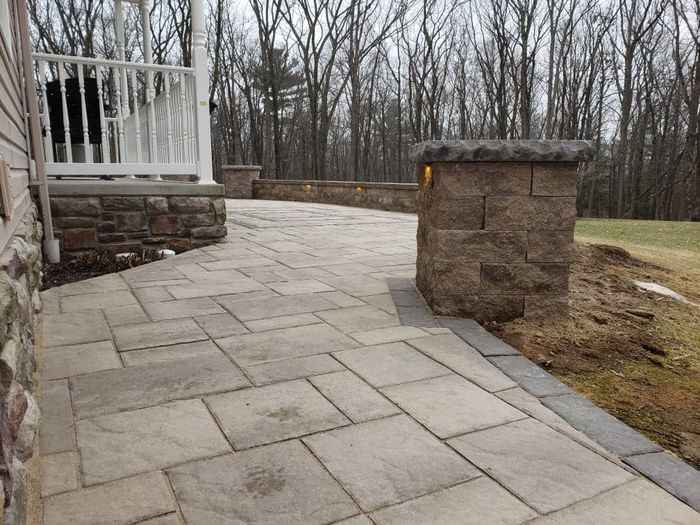 completed patio with with wall and lighting