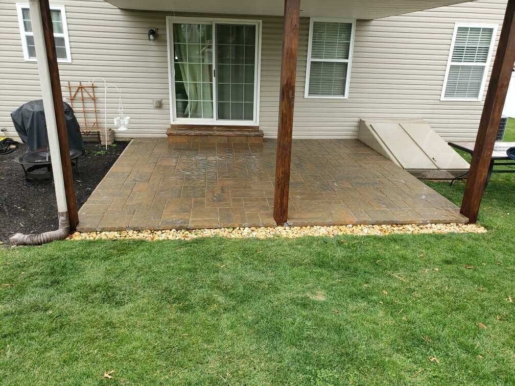 small pation of brown stone out back