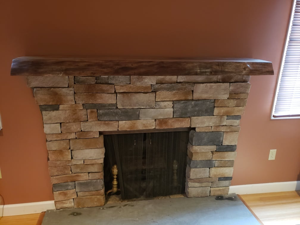 indoor stone brick variety forming fireplace