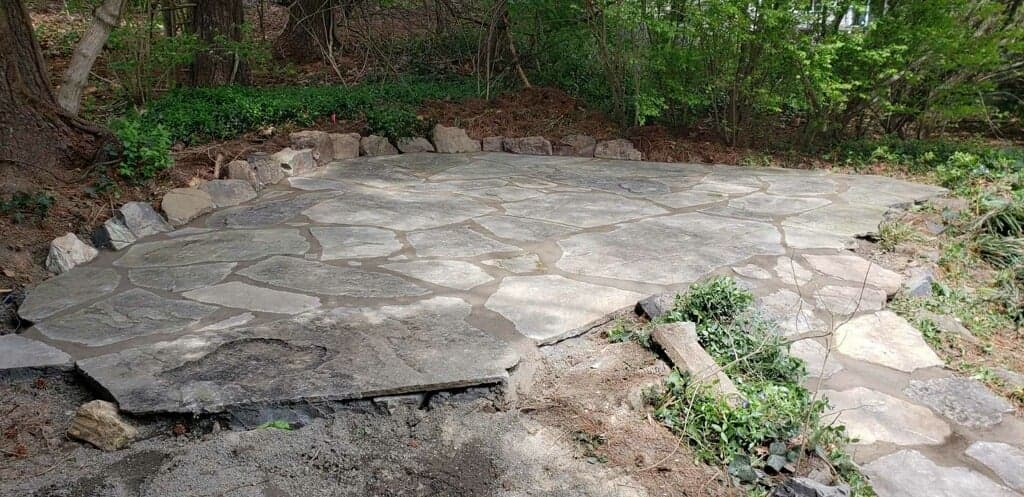 Natural stone Patio built by a hardscaper near me.