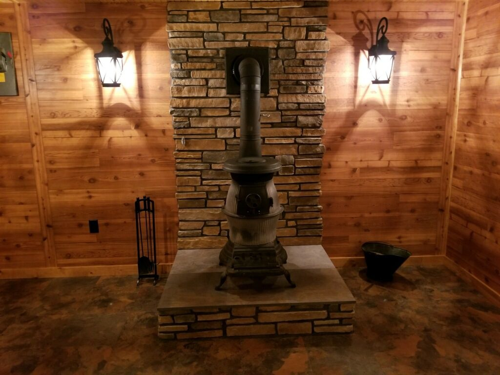 wood stove on beautiful stone floor and wall