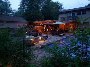 nighttime patio party by the pool