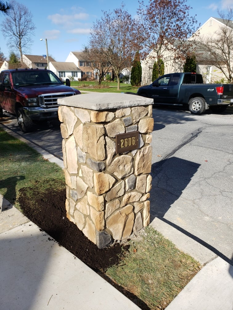 house number on natural stone mailbox